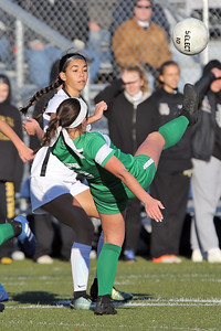 Abby Kennelly from Brick gets her foot on the ball in front of a Hopewell Valley defender as Brick Township High School hosted Hopewell Valley High School in the NJSIAA Central Jersey Group III Girls Soccer Championship at the Drum Point Sports Complex in Brick Township on Saturday November 10, 2018. (MARK R. SULLIVAN/THE OCEAN STAR)