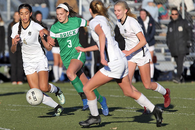 Reese Beggs (center) from Brick fights her way though Hopewell Valley defenders as Brick Township High School hosted Hopewell Valley High School in the NJSIAA Central Jersey Group III Girls Soccer Championship at the Drum Point Sports Complex in Brick Township on Saturday November 10, 2018. (MARK R. SULLIVAN/THE OCEAN STAR)
