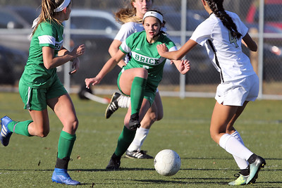 Brick's Abby Kennelly (center) fights her way though Hopewell Valley defenders as Brick Township High School hosted Hopewell Valley High School in the NJSIAA Central Jersey Group III Girls Soccer Championship at the Drum Point Sports Complex in Brick Township on Saturday November 10, 2018. (MARK R. SULLIVAN/THE OCEAN STAR)