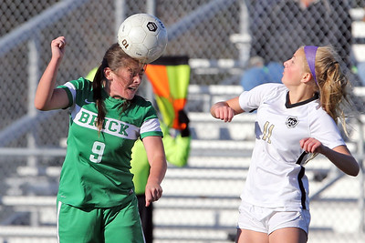 Danielle Christ (left) from Brick gets her head on the ball as  Brick Township High School hosted Hopewell Valley High School in the NJSIAA Central Jersey Group III Girls Soccer Championship at the Drum Point Sports Complex in Brick Township on Saturday November 10, 2018. (MARK R. SULLIVAN/THE OCEAN STAR)
