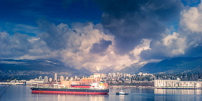 Tug escorts freighter from Vancouvers inner harbour