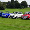 MINI - AUSTIN & MORRIS. : The Mini is a small economy car that was made by the British Motor Corporation (BMC) and its successors from 1959 until 2000. The original is considered a British icon of the 1960s, and its space-saving front-wheel drive layout – allowing 80 per cent of the area of the car's floorpan to be used for passengers and luggage – influenced a generation of car makers. The vehicle is in some ways considered the British equivalent of its German contemporary the Volkswagen Beetle, which enjoyed similar popularity in North America. In 1999 the Mini was voted the second most influential car of the 20th century, behind the Ford Model T.