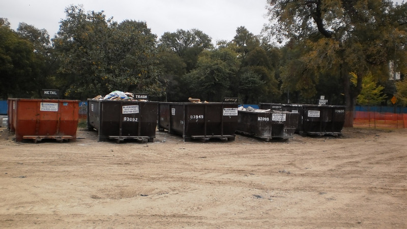 Oct. 22, 2010: Beck is sorting wood, trash, metal, concrete and sheetrock for recycling during construction.