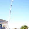 Oct. 29, 2010: This crane arrived Friday and began lifting organic materials to the living roof.
