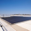 Solar Cylinders on the Collections Block with the Fort Worth Skyline in the distance