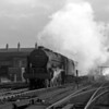 46154 The Hussar pictured at the head of a down express passing the depot just having crested Camden Bank in October 1957.  Not the best of shots but I do like the swirling exhaust.