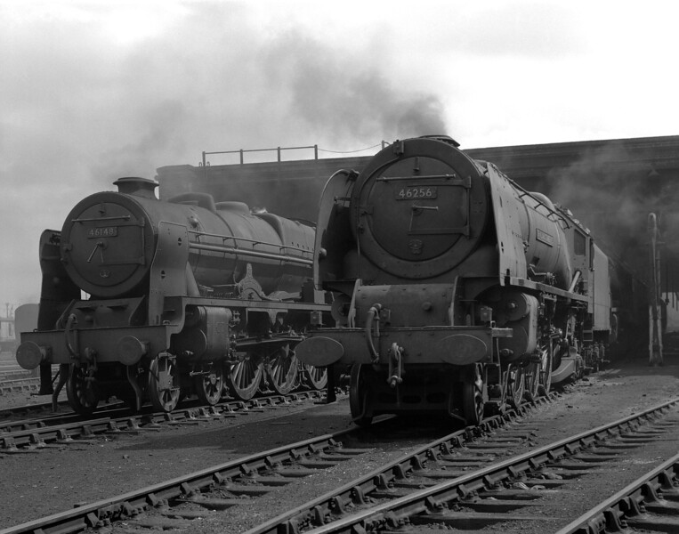 The smoky atmosphere of Camden MPD is well captured in this picture of 46256 Sir William A. Stanier, F.R.S. and 46148 The Manchester Regiment taken on 19 August 1956.