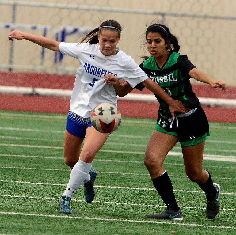 . Broomfield\'s Gia Lemley battles Fossil Ridge\'s Shreya Pandit during their playoff game on Friday night. For more photos go to bocopreps.com Paul Aiken Staff Photographer May 11, 2018.
