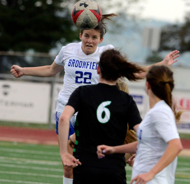. Broomfield\'s Mallory Mooney heads the ball past Fossil Ridge\'s Rachel Boyle during their playoff game on Friday night. For more photos go to bocopreps.com Paul Aiken Staff Photographer May 11, 2018.