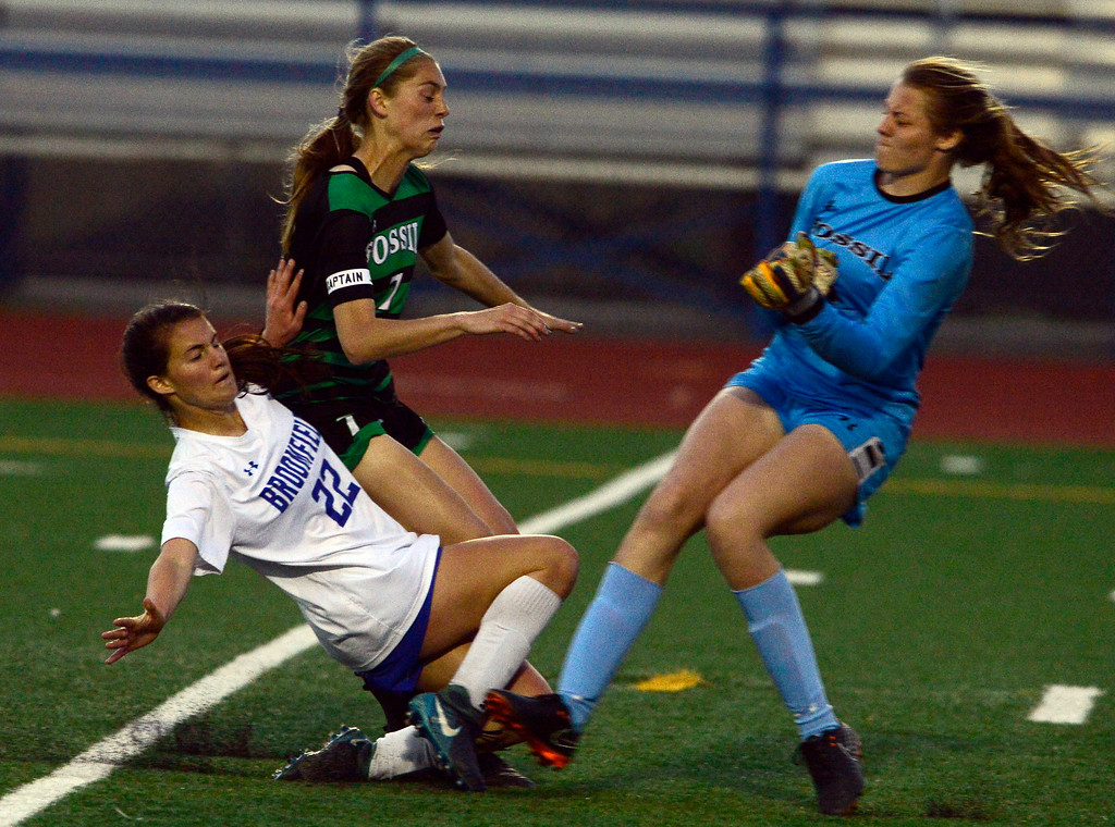 . Broomfield\'s Mallory Mooney scores the teams second goal as Fossil Ridge\'s Haley Rockwell and goalie Vicky Graham defend during their playoff game on Friday night. For more photos go to bocopreps.com Paul Aiken Staff Photographer May 11, 2018.