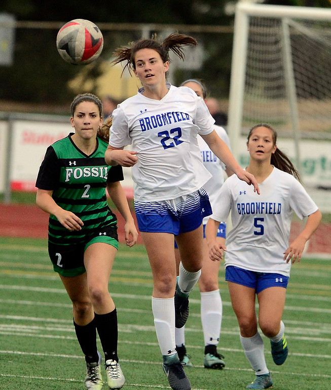 . Broomfield\'s Mallory Mooney heads the ball away from Fossil Ridge\'s Alex Lockwood during their playoff game on Friday night. For more photos go to bocopreps.com Paul Aiken Staff Photographer May 11, 2018.