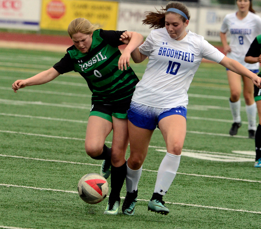 . Broomfield\'s Val Ulsh battles Fossil Ridge\'s Kylie Harger during their playoff game on Friday night. For more photos go to bocopreps.com Paul Aiken Staff Photographer May 11, 2018.