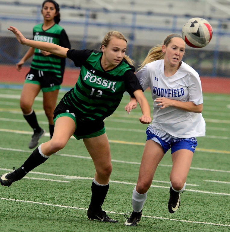 . Broomfield\'s Ashley Tuccio battles for the ball with Fossil Ridge\'s Sophia Leone during their playoff game on Friday night. For more photos go to bocopreps.com Paul Aiken Staff Photographer May 11, 2018.