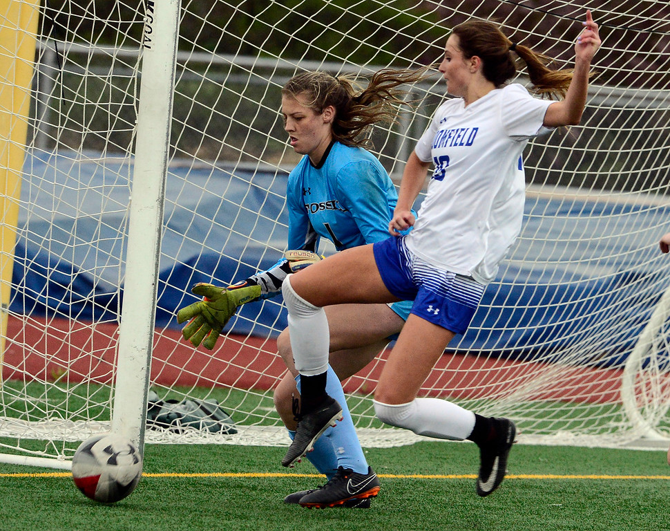 . Broomfield\'s Hailey Stodden tries to get to the ball before Fossil Ridge\'s goalie Vicky Graham during their playoff game on Friday night. For more photos go to bocopreps.com Paul Aiken Staff Photographer May 11, 2018.