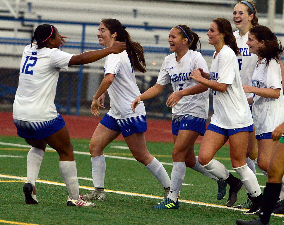 . Broomfield\'s Gia Lemley is surrounded by teammates after she scored the team\'s first goal against Fossil Ridge during their playoff game on Friday night. For more photos go to bocopreps.com Paul Aiken Staff Photographer May 11, 2018.