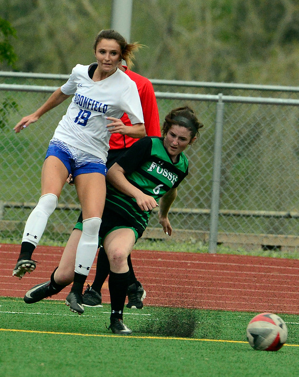 . Broomfield\'s Hailey Stodden collides with  Fossil Ridge\'s Rachel Boyle during their playoff game on Friday night. For more photos go to bocopreps.com Paul Aiken Staff Photographer May 11, 2018.