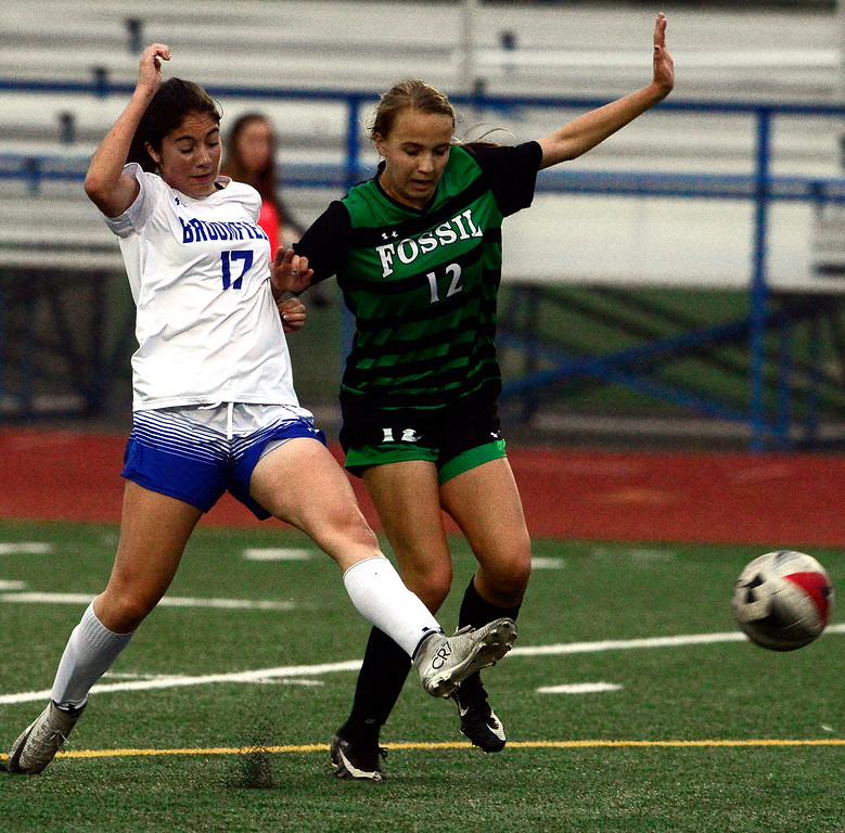 . Broomfield\'s Isabelle Sorge kicks the ball away from Fossil Ridge\'s Sophia Leone during their playoff game on Friday night. For more photos go to bocopreps.com Paul Aiken Staff Photographer May 11, 2018.