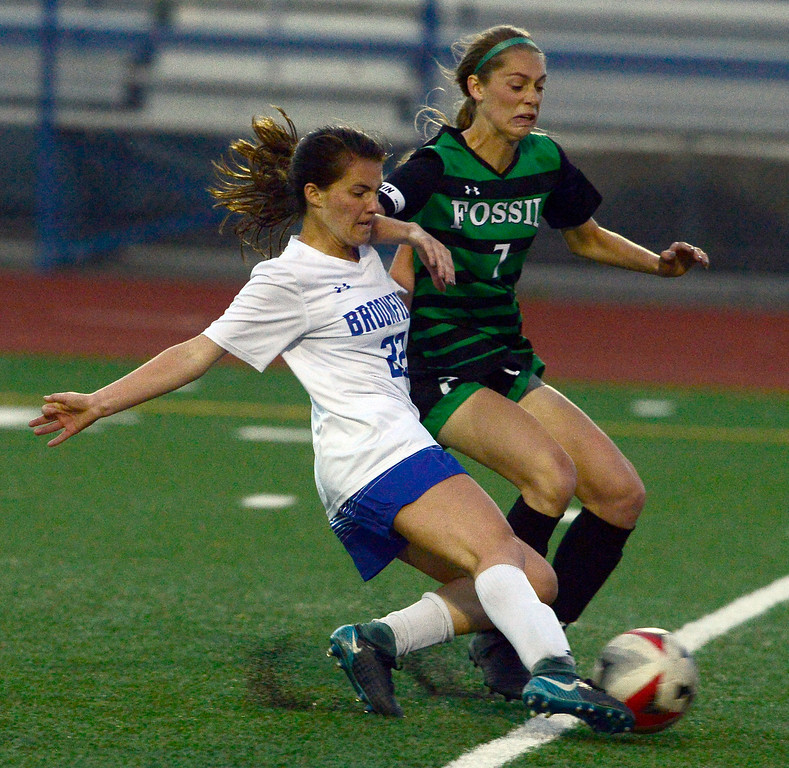 . Broomfield\'s Mallory Mooney scores the teams second goal as Fossil Ridge\'s Haley Rockwell defends during their playoff game on Friday night. For more photos go to bocopreps.com Paul Aiken Staff Photographer May 11, 2018.