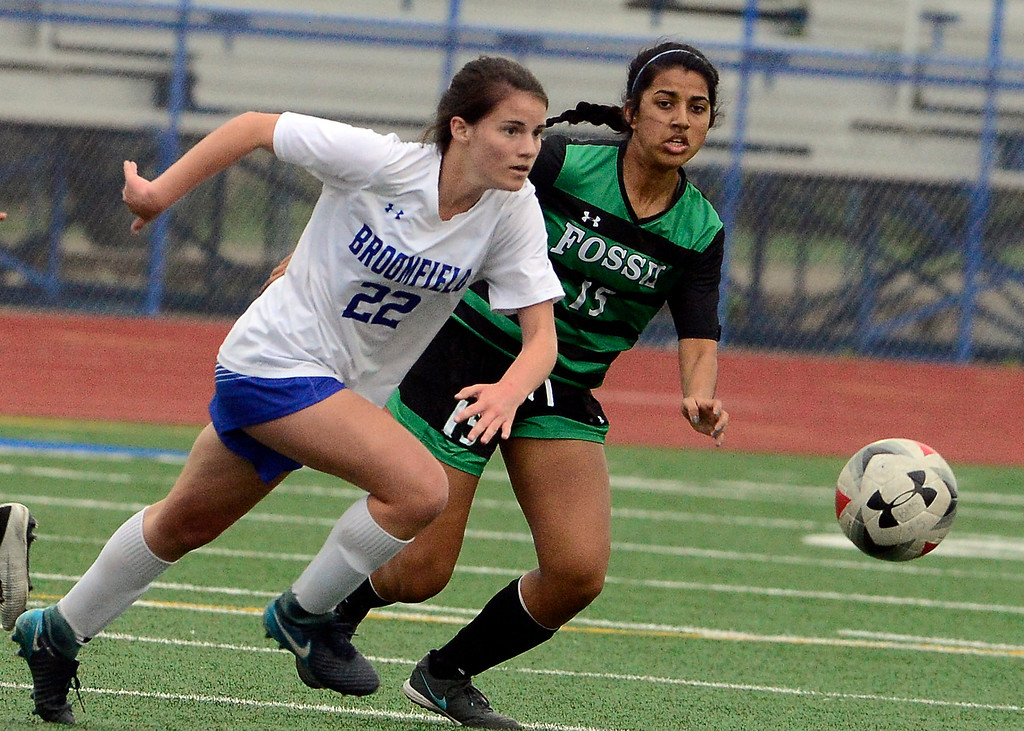 . Broomfield\'s Mallory Mooney pushes the ball away from Fossil Ridge\'s Shrey Pandit during their playoff game on Friday night. For more photos go to bocopreps.com Paul Aiken Staff Photographer May 11, 2018.