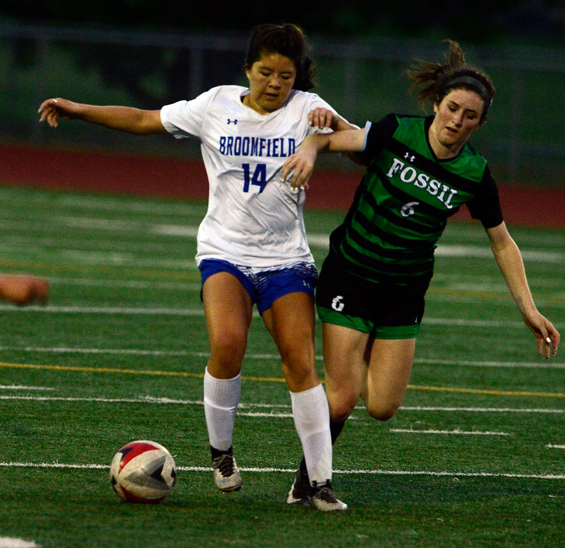 . Broomfield\'s Lindsay Hudson controls the balls against Fossil Ridge\'s Rachel Boyle during their playoff game on Friday night. For more photos go to bocopreps.com Paul Aiken Staff Photographer May 11, 2018.