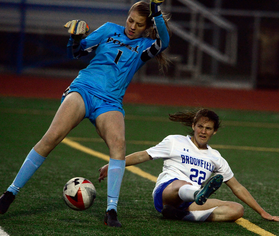 . Broomfield\'s Mallory Mooney collides with Fossil Ridge\'s goalie Vicky Graham after she was bumped from behind during their playoff game on Friday night. For more photos go to bocopreps.com Paul Aiken Staff Photographer May 11, 2018.