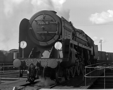 A less than pristine 70004 William Shakespeare is captured on the turntable at Dover MPD in summer 1956.  The mark left by the Golden Arrow insignia is clearly seen on the smoke deflector.