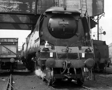 Battle of Britain Class 34068 Kenley under the coaling tower at Exmouth Junction MPD in August 1961.