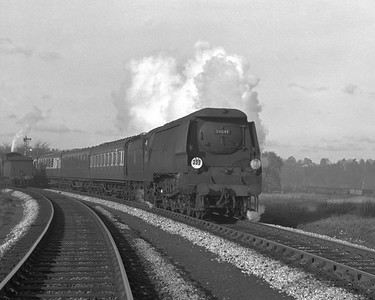 A very grubby West Country class 34041 Wilton heads the down Birkenhead-Bournemouth round the curve from Reading West Junction to Reading West station.  The photograph is undated but appears to be taken c.1957.
