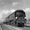A quarter plate shot of Bullied West Country class 34095 Brentor leaving Southcote Junction on the Basingstoke branch at the head of the Birkenhead-Bournemouth.  The photograph is dated 10 April 1953.