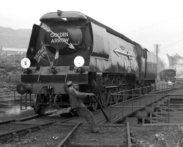 Another version of one of my father's favourite subjects:  locomotives on turntables, with an emphasis on capturing the effort of the railwayman.  Here, Battle of Britain class 34085 501 Squadron is seen on Golden Arrow duty at Folkestone Junction in August 1958.  On this occasion the weather was clearly dull and grey!