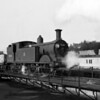 Class M7 30318 crossing the turntable at Bournemouth MPD in 1959.  I took this photograph myself (aged 12) on a Zeiss Ikon Nettar.