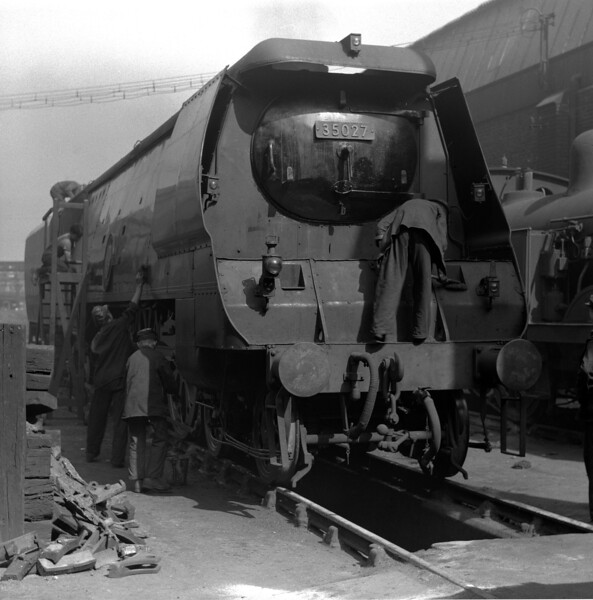 35027 Port Line being prepared for duty at Stewarts Lane MPD during a Railway Photographic Society visit in 1953.