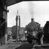 Ivatt Class 2 2-6-2T viewed from under the coaling plant at Stewarts Lane MPD in 1953.  Fowler Class 4 2-6-4T can be seen behind the water crane.