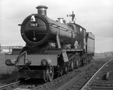 "In another shot of the ""running in"" turn, 7917 North Aston Hall awaits departure from Reading MPD in 1957.  The detailed differences introduced in the Modified Hall are clearly seen."