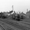 A general view of the east end of Reading MPD in 1957/58 featuring  61xx class locomotives 6147 and 6103 as well as Modified Halls 7906 Fron Hall and 7919 Runter Hall.   A WD 2-8-0 can be glimpsed to the right.
