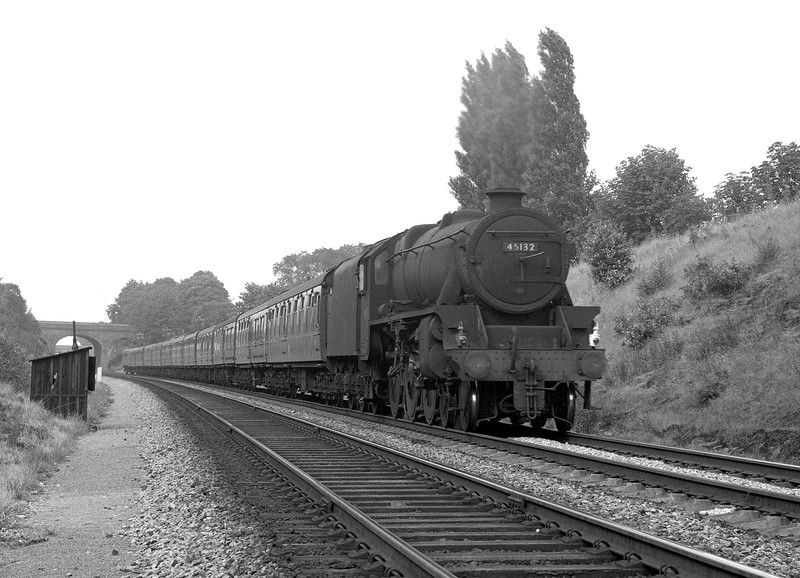This is included here as something of an oddity.  Black 5 45132 approaching Southcote at the head of an express train. This was a loose negative with no indication of date, but it is likely to date to the period around 1965 when the Pines Express was diverted via Reading after the closure of the S&DJR.