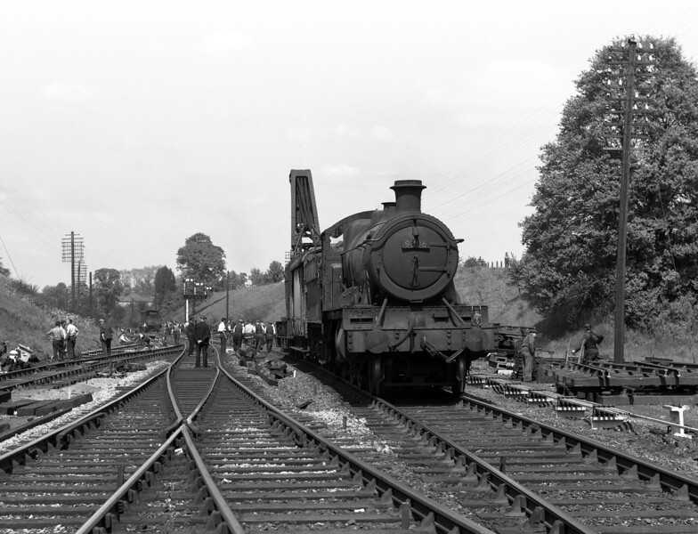On 26 May 1956, the junction with the single line to Reading Central Goods was simplified by removal of the double track entry to the branch and its replacement with a single point from the down main and a new crossover on the Reading West side of that point.  The works train was hauled by 4300 class Mogul 9306, pictured here.