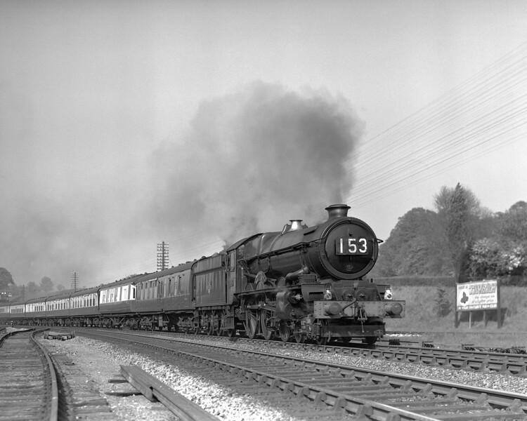 """This is yet another shot of the 3.30 Paddington to Penzance passing Southcote Junction.  This time the locomotive is 6003 King George IV.  The date is uncertain, but after the relaying of the junction in mid-1956.  It could be as late as July 1958, when KGIV received its double chimney.  The quarter plate negative posed some problems.  The image was not entirely straight and the necessary cropping has resulted in the loss of the end of the train!  There was also a """"difficult"""" shadow just behind the near side of the buffer beam, but overall, I could not resist including this picture because the image of the train is so bright and clear."""