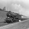 An unidentified King (possibly 6017 King Edward IV) heads the down Cornish Riviera approaching Southcote Junction on 25 March 1953.