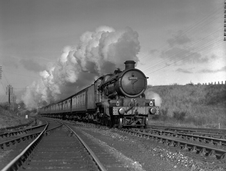 7019 Fowey Castle heads a down express through Southcote Junction in the early 1950s.
