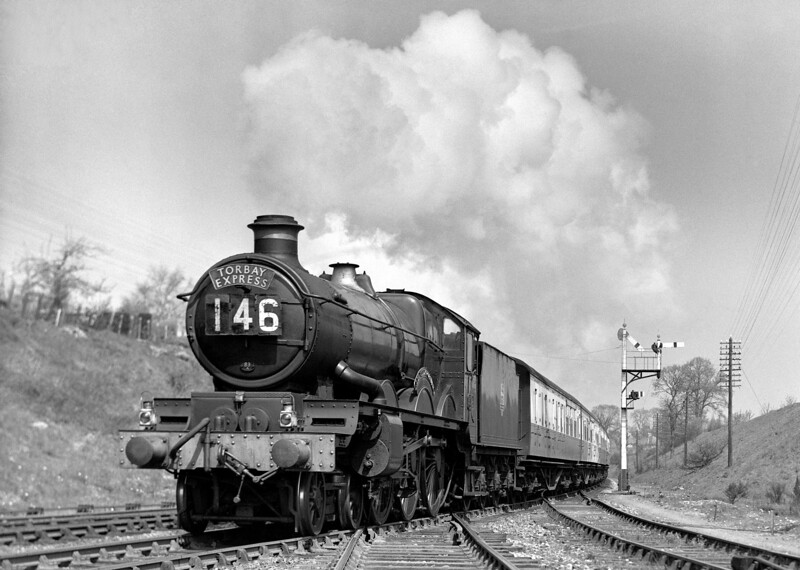 An unidentified Castle heads the Torbay Express (12.00 ex-Paddington) past Southcote Junction on 23 April 1953.