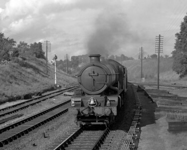 This picture gives a signalman's eye view of 6000 King George VI heading a down express past Southcote Junction and was taken from the top of the signal box steps.  The date is uncertain but is likely to be in summer 1956 shortly after the junction with the Coley branch was relaid.
