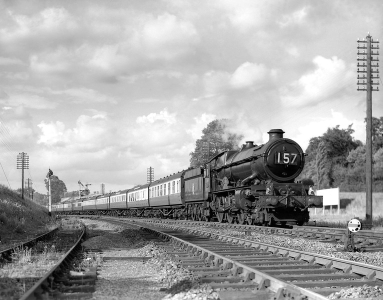 This shot on quarter plate dates to the early 1950s:  the bracket signal in the background was replaced early in 1955.  On this occasion, the 5.30pm ex-Paddington is headed by a King (probably 6015 King Richard III as far as I can tell from examining the image) and is closer to the signal box itself.