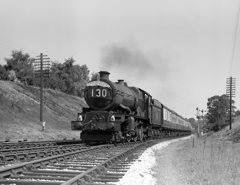 This is another variation on the theme!  The locomotive heading the Cornish Riviera Express is cautiously identified as King Class 6007 King William III.  6007 had its double chimney fitted in September 1956 and this shot cannot be too much later than that as the tender still bears the early BR totem.