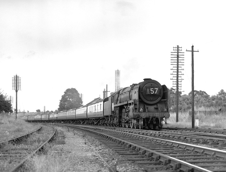 70016 Ariel passing Southcote in the early 1950s at the head of the 5.30 ex-Paddington, so this shot was taken quite late in the evening.  My mother and I can just be glimpsed on the other side of the fence!