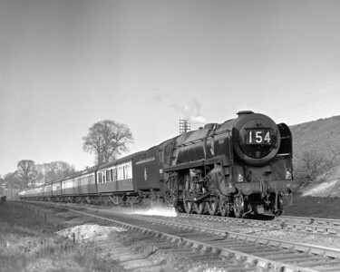 Britannia class 70017 Arrow approaches Southcote at the head of the 3.30 Paddington to Penzance on 25 March 1953.  There is evidence of some sort of leak just behind the smoke deflector!  This shot, on the quarter plate Adams Reflex was taken whilst the locomotive was still allocated to Old Oak Common MPD.