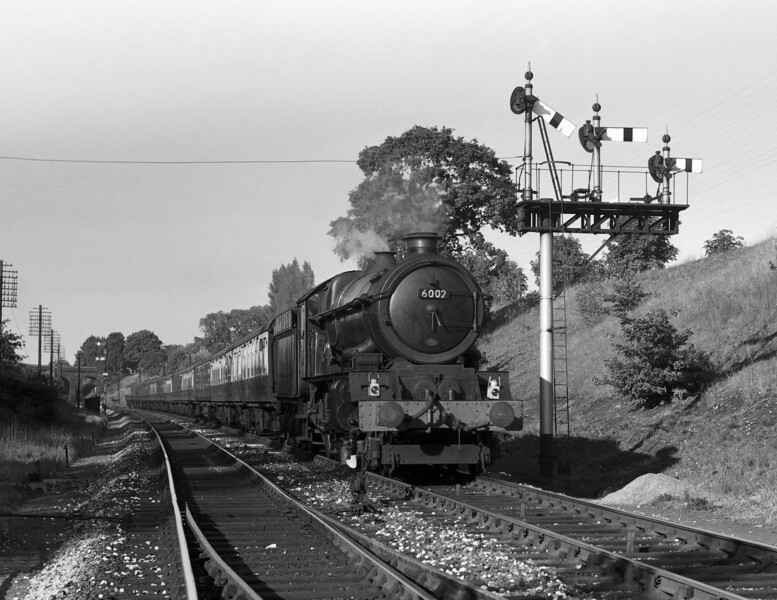 6002 King William IV on the 3.30pm ex-Paddington at the Southcote bracket signal in August 1959.