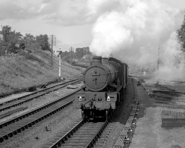 This is another photograph from the steps of Southcote Junction signal box.  This time 5029 Nunney Castle heads a down express.  5029 was one of the Castle class lucky enough to survive into preservation and the shot is included because it is always good to see pictures of preserved locomotives during their BR working lives.  Although the date is uncertain, it is likely to be in the summer of 1956 shortly after the Coley branch junction was relaid.