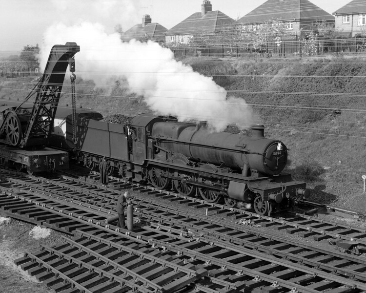 Collett Hall 5974 Wallsworth Hall edges past the relaying work at Southcote on 26 May 1956.