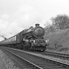 This picture of the now preserved King Class 6024 King Edward I dates from approximately 1956 before the fitting of a double chimney in March 1957.  6024 is approaching Southcote Junction from Reading West.